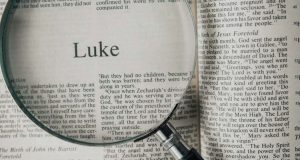 Bible opened to the Gospel of Luke