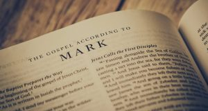 Bible opened to the Gospel of Mark