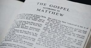 Bible opened to the Gospel of Matthew
